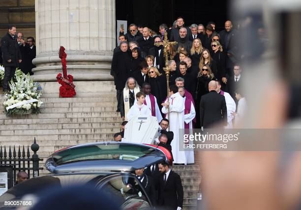 Pallbearers carry the coffin in the hearse outside the La Madeleine Church at the end of the funeral ceremony in tribute to late French singer Johnny...
