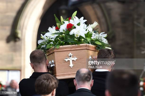 Pallbearers carry the coffin into Stoke Minster church for the funeral service of England's former goalkeeper Gordon Banks in StokeonTrent central...