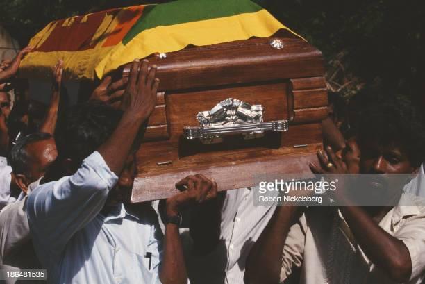 Pallbearers carry the coffin of a Sri Lankan soldier killed fighting Tamil Tigers in Jaffna Sri Lanka circa 1998