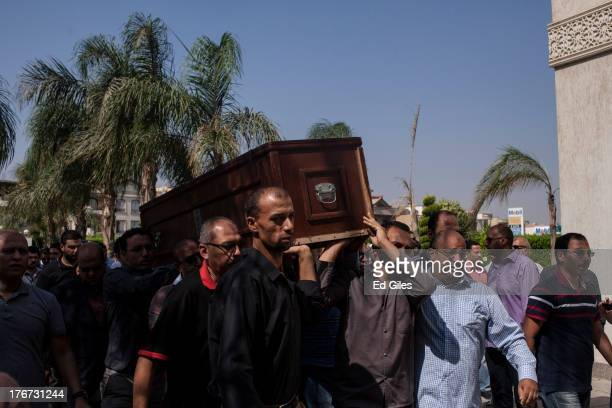 Pallbearers carry the coffin of Ammar Badie son of the Muslim Brotherhood's Supreme Guide Mohammed Badie during a funeral at the Hammad Mosque in the...