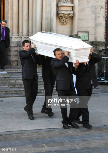 Pallbearers carry the coffin of Angelique the 13yearold girl who was killed and raped on April 25 2018 during her funerals on May 5 2018 in...
