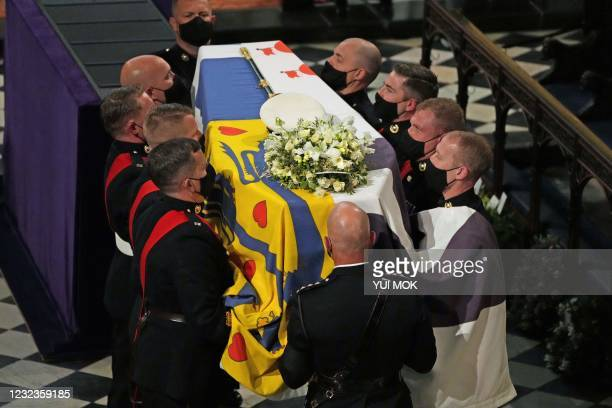 Pallbearers carry the coffin of Britain's Prince Philip, Duke of Edinburgh into St George's Chapel in Windsor Castle in Windsor, west of London, on...