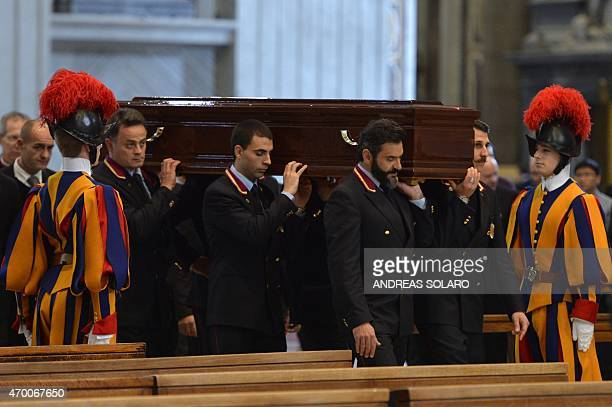 Pallbearers carry the coffin of Cardinal Roberto Tucci during his funeral at St Peter's basilica on April 17 2015 at the Vatican AFP PHOTO / ANDREAS...