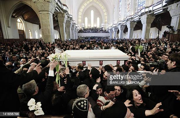Pallbearers carry the coffin of Coptic Pope Shenuda III out of Saint Mark's cathedral during his funeral service in Cairo's alAbbassiya district on...