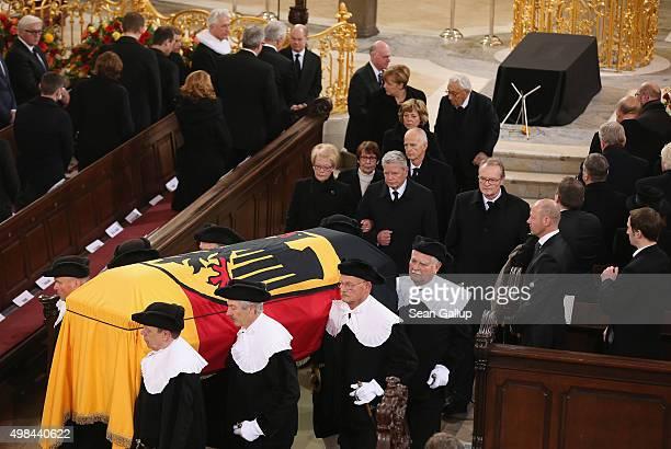 Pallbearers carry the coffin of former German Chancellor Helmut Schmidt out of Sankt Michaelis church as German President Joachim Gauck and German...