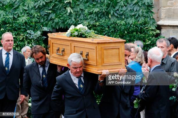 Pallbearers carry the coffin of French actor Claude Rich during a funeral ceremony at the SaintPierre SaintPaul church in Orgeval northcentral France...