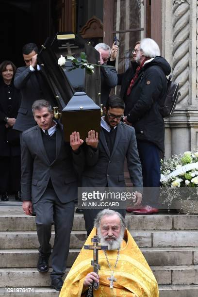 Pallbearers carry the coffin of French music composer Michel Legrand at the end of the funeral ceremony at the Saint Alexandre Nevski Cathedral in...