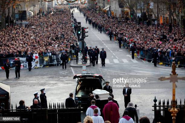 Pallbearers carry the coffin of French musician Johnny Hallyday into a hearse following the funeral service of Hallyday at La Madeleine Church in...