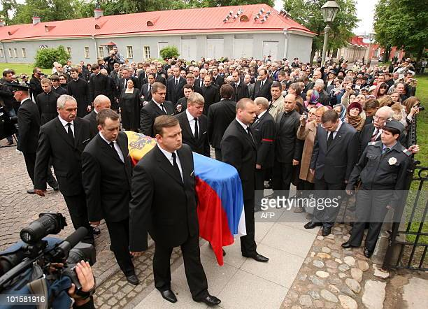 Pallbearers carry the coffin of Grand Duchess Leonida Georgievna of the Romanov dynasty into the crypt in St Petersburg on June 3 2010 during her...
