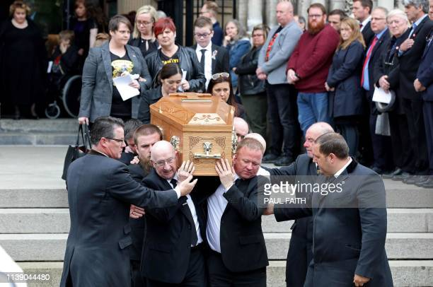Pallbearers carry the coffin of journalist Lyra McKee killed by a dissident republican paramilitary in Northern Ireland on April 18 as they leave St...