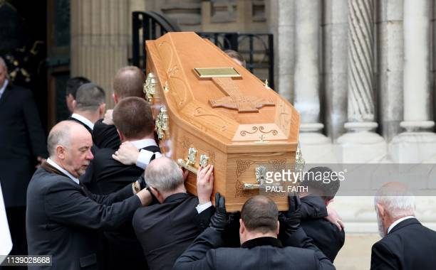 Pallbearers carry the coffin of journalist Lyra McKee who was killed by a dissident republican paramilitary in Northern Ireland on April 18 for the...