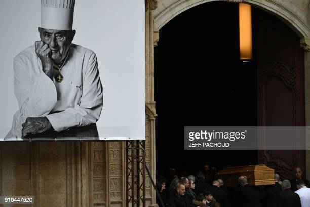 Pallbearers carry the coffin of late French chef Paul Bocuse during the funeral ceremony at the SaintJean Cathedral in Lyon on January 26 2018 More...