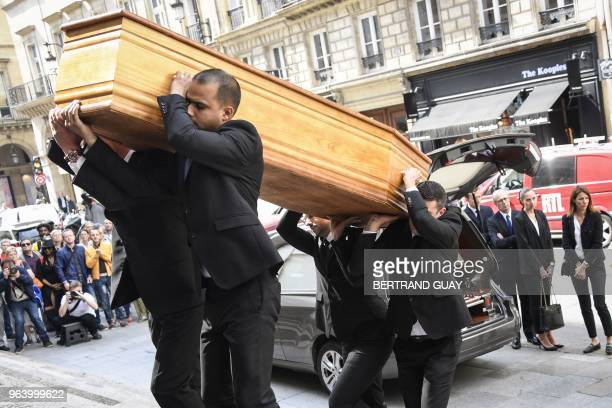 Pallbearers carry the coffin of late French radio and tv host producer writer and journalist Pierre Bellemare at the SaintRoch church in Paris on May...