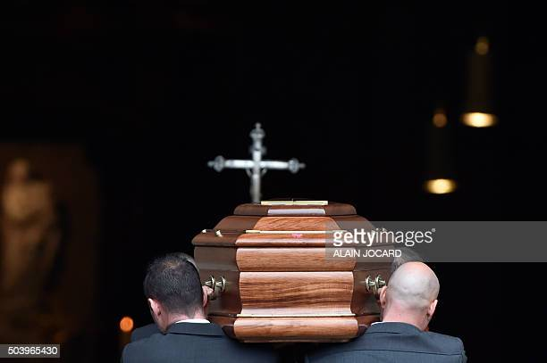 Pallbearers carry the coffin of late French singe Michel Delpech prior to his funeral ceremony on January 8 2016 at SaintSulpice church in Paris...
