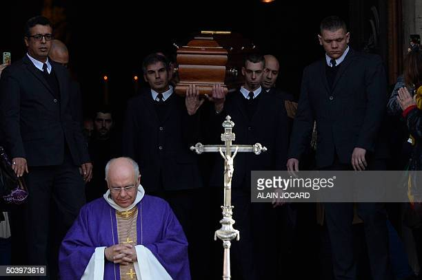 Pallbearers carry the coffin of late French singer Michel Delpech after his funeral ceremony on January 8 2016 at SaintSulpice church in Paris French...
