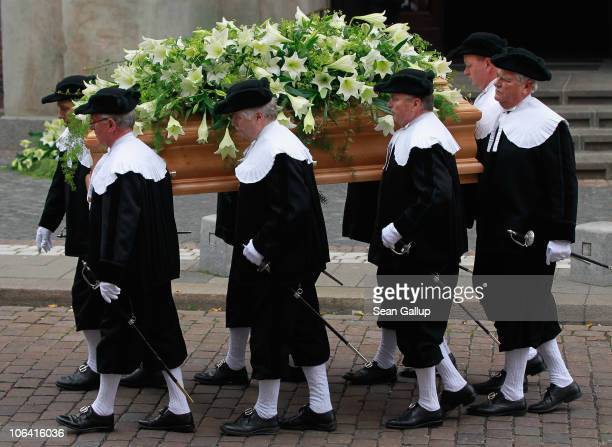 Pallbearers carry the coffin of Loki Schmidt wife of former German Chancellor Helmut Schmidt following a memorial service for her at the St Michaelis...