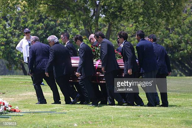 Pallbearers carry the coffin of Matthew Ansara the son of actress Barbara Eden July 2 2001 at Ansara''s funeral in Hollywood CA Matthew Michael...