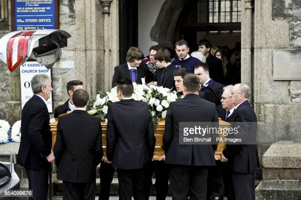 Pallbearers carry the coffin of of Jordan Cobb who died after jumping from the Torpoint ferry on New Years Eve 2012 out from Minster Church of St...