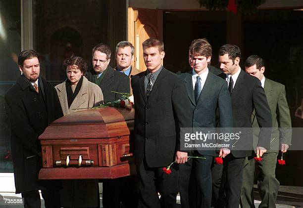 Pallbearers carry the coffin of Paul Marceau January 3 2001 from St Matthew's Church in Windham NH Marceau was one of seven people killed in last...