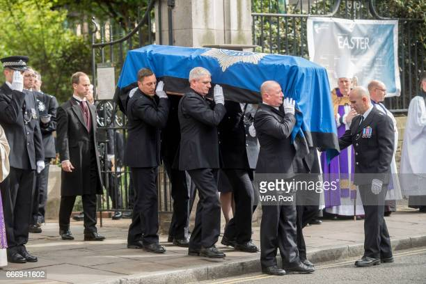Pallbearers carry the coffin of PC Keith Palmer during his funeral service on April 10 2017 in London United Kingdom A Full Force funeral is held for...