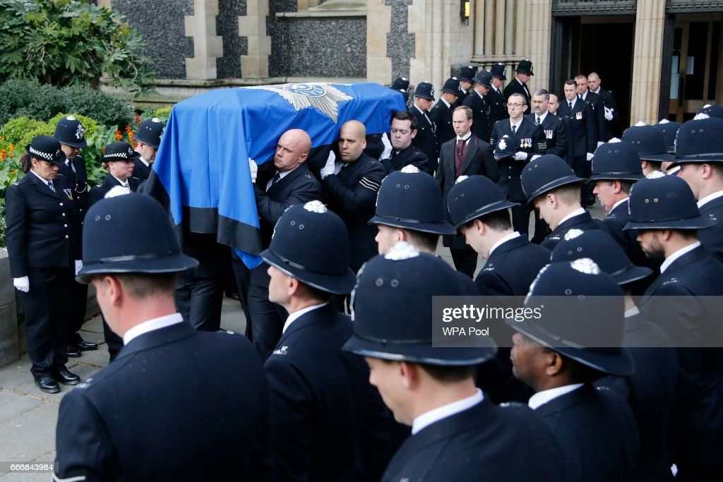 Pallbearers carry the coffin of PC Keith Palmer from Southwark Cathedral following his funeral service, on April 10, 2017 in London, United Kingdom. A Full Force funeral is held for PC Keith Palmer who was killed in a terrorist attack in Westminster whilst on duty on March 22, 2017. The funeral is attended by his family, including his wife and child, and officers from the Metropolitan Police who served alongside him. Officers from the wider service across England and Wales also attend to honour their fallen colleague.
