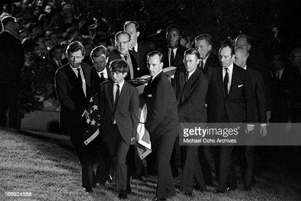 Pallbearers carry the coffin of Senator Robert Kennedy to the grave site at Arlington National Cemetery on June 9 1968 in Arlington County Virginia