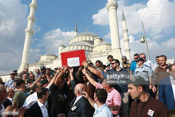Pallbearers carry the coffin of special forces police officer Meric Alemdar killed during the failed July 15 coup attempt during a funeral ceremony...