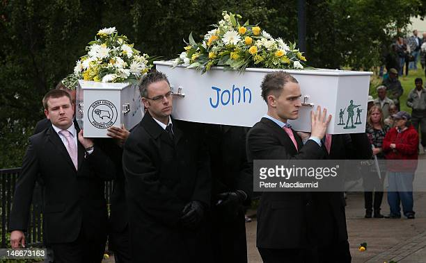 Pallbearers carry the coffins of John Philpott and his brother Duwayne to St Mary's Church on June 22 2012 in Derby England Hundreds of people...