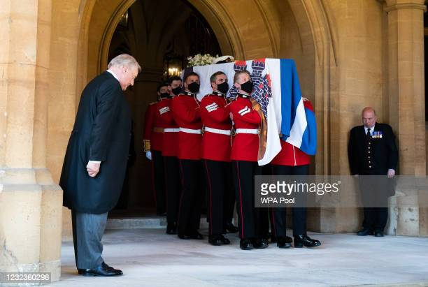 Pallbearers carry The Duke of Edinburgh's coffin, covered with his Personal Standard, to the purpose built Land Rover Defender hearse during the...