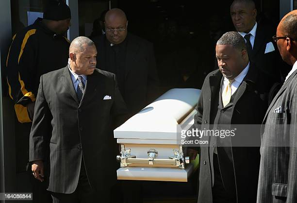 Pallbearers carry the remains of sixmonthold Jonylah Watkins from New Beginnings Church following her funeral service on March 19 2013 in Chicago...