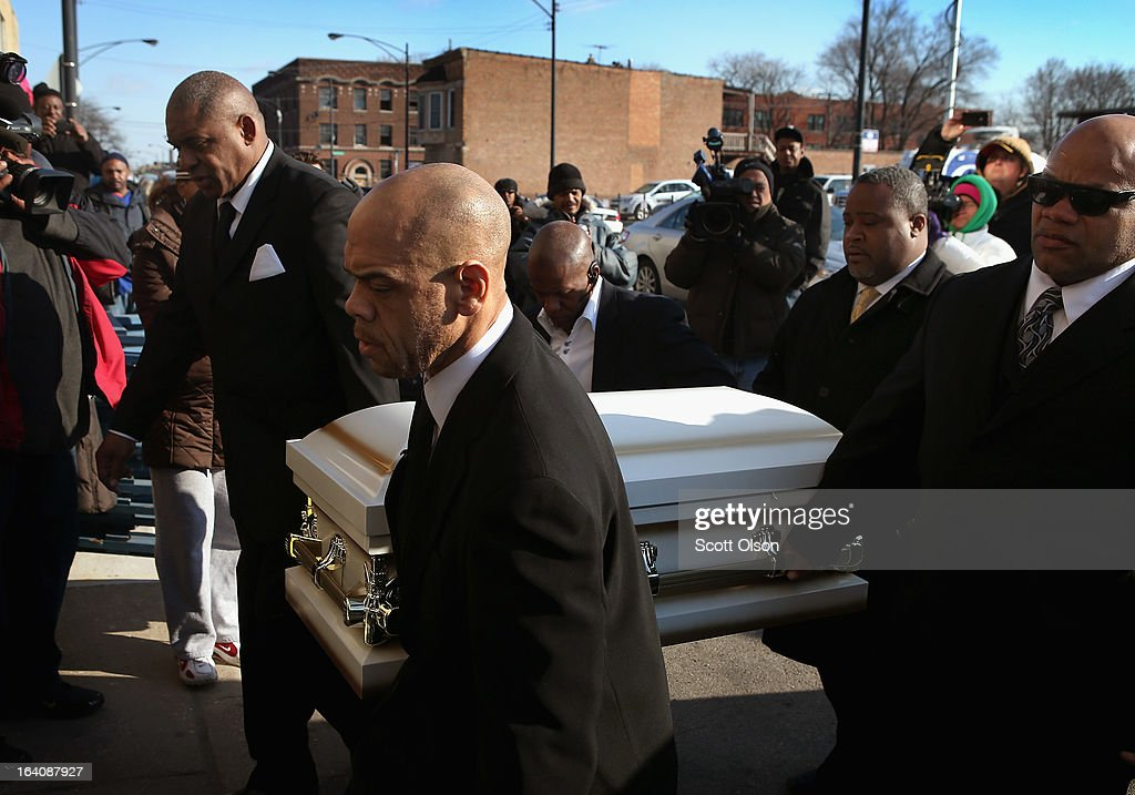 Pallbearers carry the remains of six-month-old Jonylah Watkins into New Beginnings Church for her funeral service on March 19, 2013 in Chicago, Illinois. Watkins was shot, along with her father, while sitting on her father's lap in the family's minivan March 11. Jonylah died the following day. Her father is recovering from his wounds.