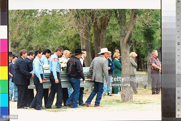 Pallbearers carrying casket of suicide victim Robert O'Donnell through trees at Resthaven Memorial Park cemetery in 1987 he saved 2yrold Jessica...