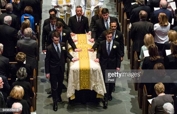 Pallbearers escort the coffin of former first lady Barbara Bush after funeral services at St Martin's Episcopal Church on April 21 2018 in Houston...