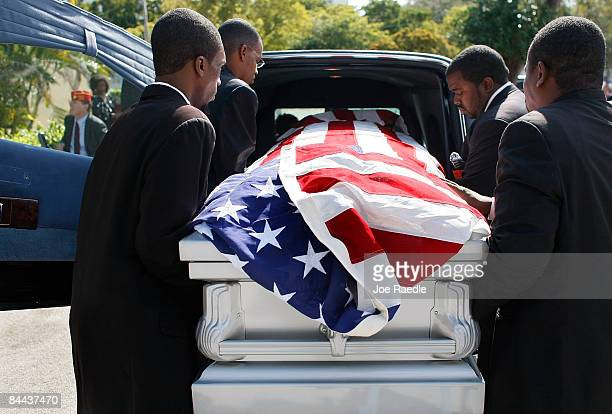 Pallbearers for Poitier Funeral home load one of the four flag draped caskets holding the remains of four homeless United States military veterans...