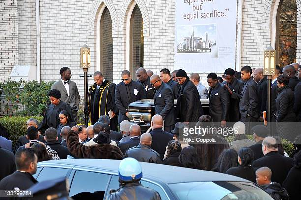 Pallbearers help carry the casket of rapper Heavy D at his funeral service at Grace Baptist Church on November 18 2011 in Mount Vernon New York