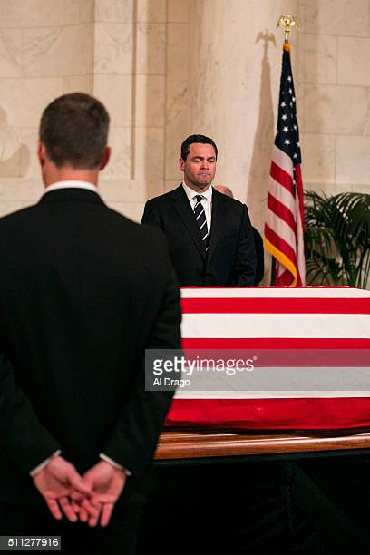 STATES FEB 19 Pallbearers hold their hands as they stand watch as members of the public pass through the Great Hall of the Supreme Court as they pay...