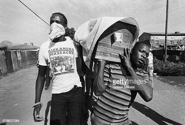 pallbearers in funeral procession in south africa - pallbearer stock pictures, royalty-free photos & images