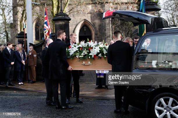 Pallbearers including goalkeepers Jack Butland and Joe Hart help carry the coffin of recently deceased former England goalkeeper Gordon Banks outside...