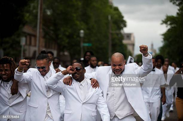 Pallbearers lead a march down Selby Avenue after the funeral of Philando Castile at the Cathedral of St Paul on July 14 2016 in St Paul Minnesota...