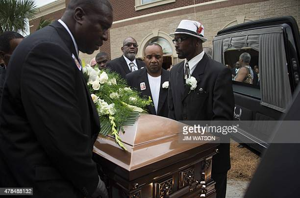 Pallbearers load the casket holding Emanuel AME Church shooting victim Ethel Lance during her funeral at the Royal Missionary Baptist Church in North...