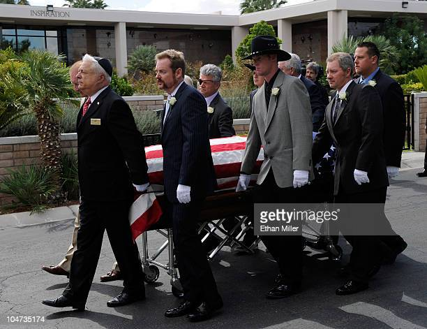 Pallbearers move Tony Curtis' coffin to his burial site at Palm Mortuary Cemetary October 4 2010 in Henderson Nevada Curtis died on September 29 at...