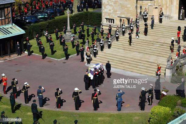 Pallbearers of the Royal Marines carry the coffin as it arrives at the West Steps of St George's Chapel during the ceremonial funeral procession of...