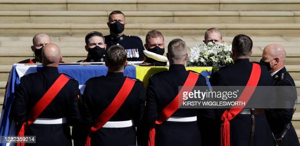 Pallbearers of the Royal Marines carry the coffin at the West Steps of St George's Chapel to mark the start of the funeral service of Britain's...