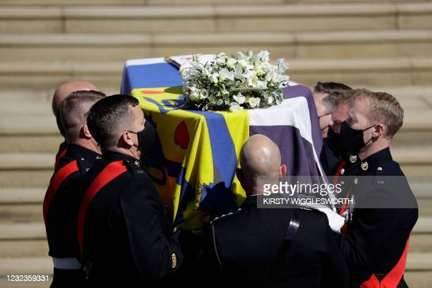 Pallbearers of the Royal Marines carry the coffin at the West Steps of St George's Chapel during the ceremonial funeral procession of Britain's...