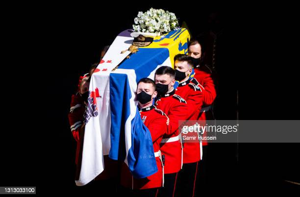 Pallbearers of the Royal Marines carry the coffin during the funeral of Prince Philip, Duke of Edinburgh on April 17, 2021 in Windsor, England ....
