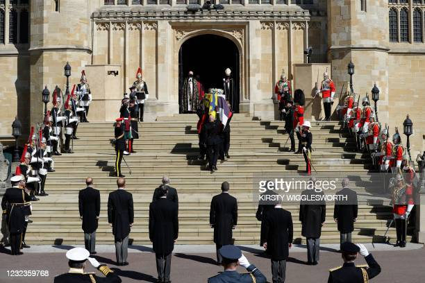 Pallbearers of the Royal Marines carry the coffin in front of the members of the Royal family at the West Steps of St George's Chapel to mark the...