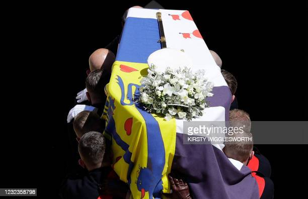 Pallbearers of the Royal Marines carry the coffin into St George's Chapel during the ceremonial funeral procession of Britain's Prince Philip, Duke...