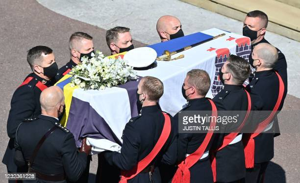 Pallbearers of the Royal Marines carry the coffin into St George's Chapel to mark the start of the funeral service of Britain's Prince Philip, Duke...
