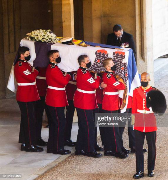 Pallbearers of the Royal Marines carry the coffin of the Duke of Edinburgh during the funeral of Prince Philip, Duke of Edinburgh on April 17, 2021...