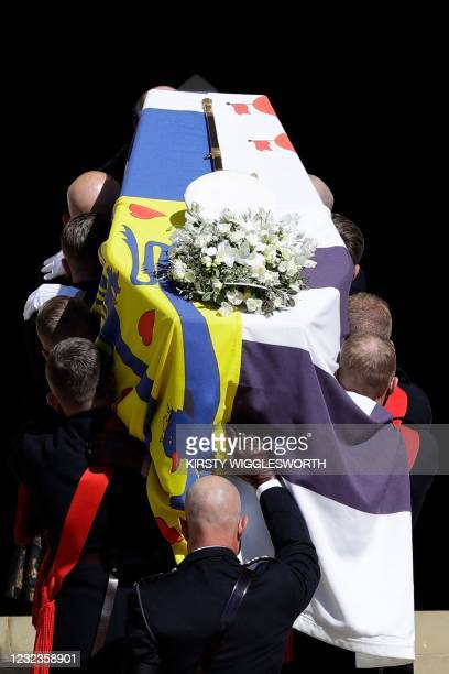 Pallbearers of the Royal Marines carry the coffin on the West Steps of St George's Chapel during the ceremonial funeral procession of Britain's...